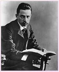 rilke holding book open 204 x 247