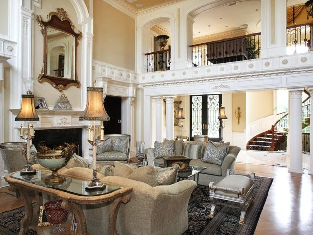Every Detail in the Two Story Living Room Is Done with Precision from the Crown Moldings to the Carvings on the Fireplace  800x600