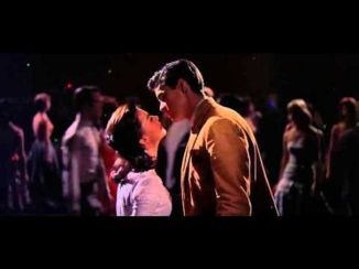 west side story at dance tony and maria leaning in toward each other 1
