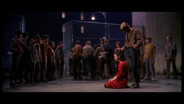 west side story both gangs carrying tony away while maria is kneeling 1