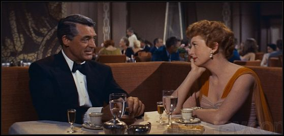 an affair to remember in diningroom on ship looking at each other