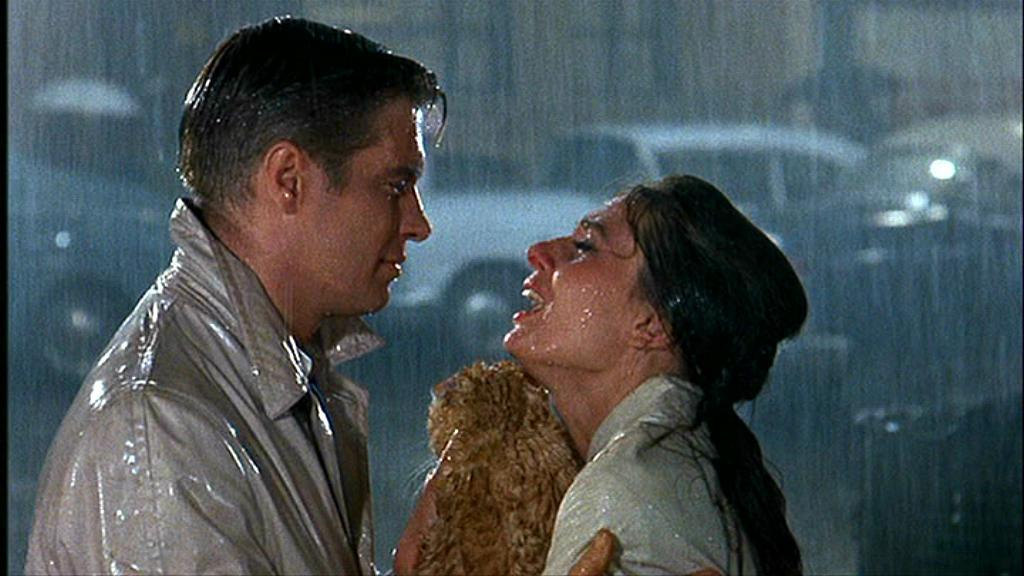 Image result for breakfast at tiffany raining scene