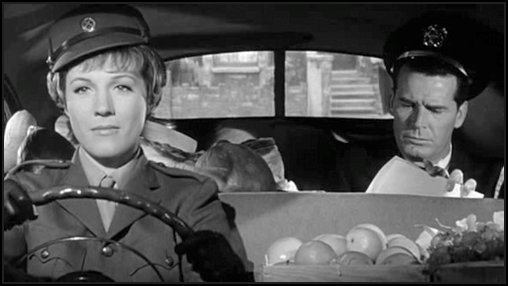 Emily driving Commander Charlie Madison back to the hotel after they collected supplies of food for his Admiral while they're staying London just near the time of D-Day WWII