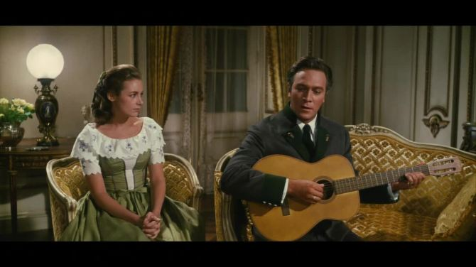 the sound of music liesel on couch next to father singing edelweiss