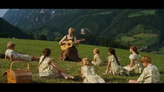 the SoundofMusic maria w children on mtn teaching them how to sing