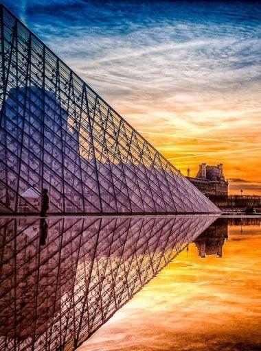 paris louvre at sunset pyramid w reflection