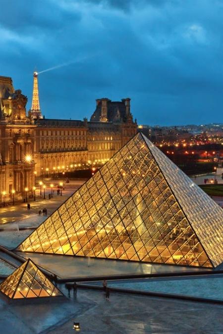 paris louvre pyramid at night golden