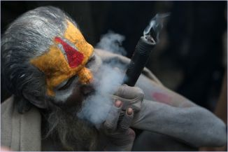 A Sadhu (Hindu holy man) smokes ganja (marijuana) in a chillum (traditional clay pipe) as a holy offering from lord Shiva, Hindu god of creation and destruction at the Pashupatinath temple during the Hindu festival Maha Shivaratri in Kathmandu on February 12, 2010. Hindus mark the Maha Shivratri festival by offering special prayers and fasting. Hundreds of sadhu arrived in pashupatinath to take part in the Maha Shivaratri festival. AFP PHOTO / Prakash MATHEMA (Photo credit should read PRAKASH MATHEMA/AFP/Getty Images)