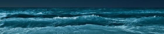 ocean-waves-at-night long photo horizontally