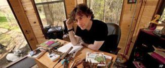 NEIL-GAIMAN at writing desk