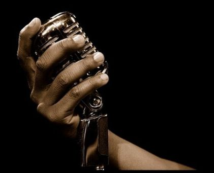 hand-holding-classic-retro-jazz-microphone CROP