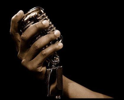 hand-holding-classic-retro-jazz-microphone CROP