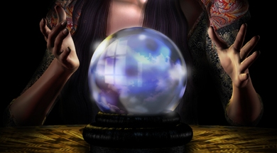 crystal ball with hands close but not touching