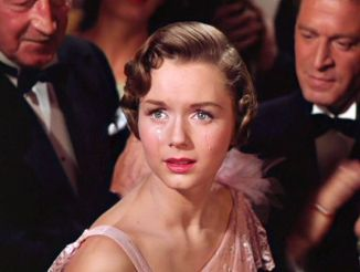 Debby Reynolds at theend of Singin' In The Rain' running up the aisle. She turns when she hears Gene Kelly acknowledging her as the Star. She became a Star due to this film and she became a Star within the film.